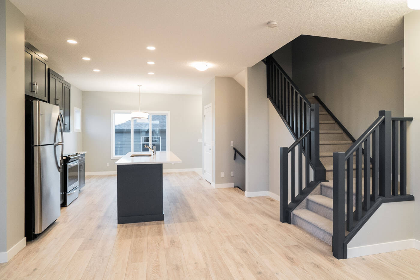 New Calgary Paired Home Quick Possession Cobalt 1 in Walden, located at 1346 Walden Drive SE Built By Cardel Homes Calgary
