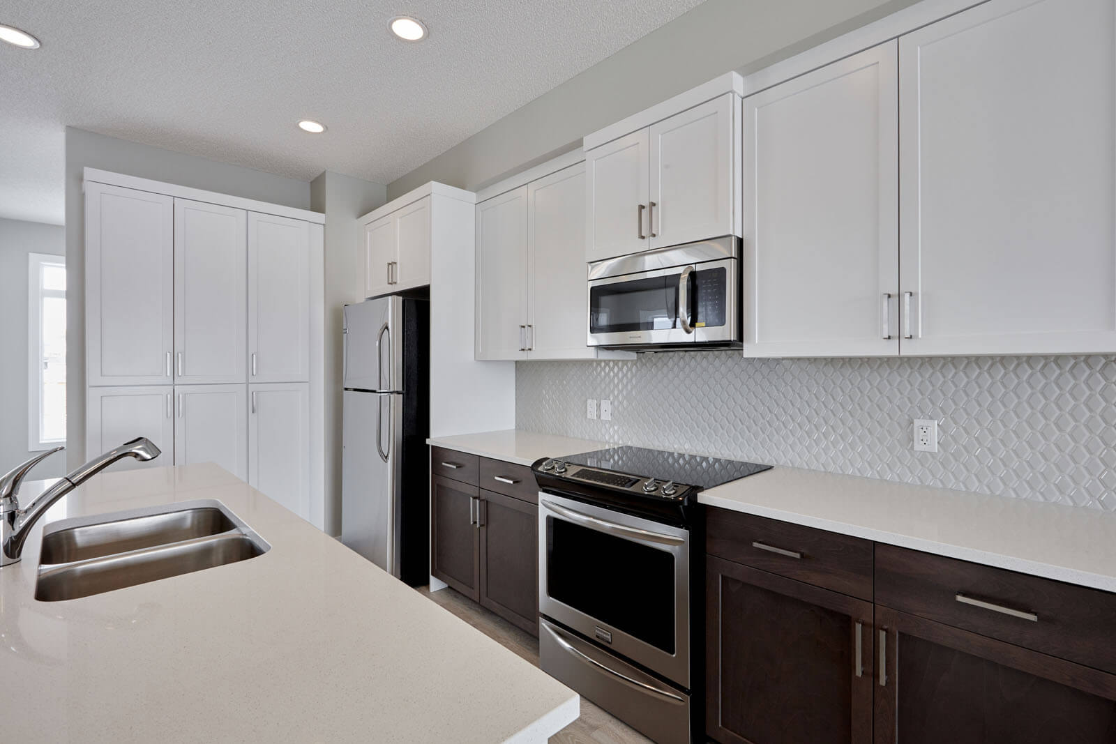 New Calgary Paired Home Quick Possession Indigo 2 in Walden, located at 32 Walgrove Drive SE Built By Cardel Homes