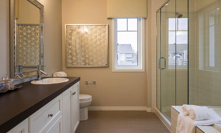 Master bedroom bathroom features glass shower doors and large window