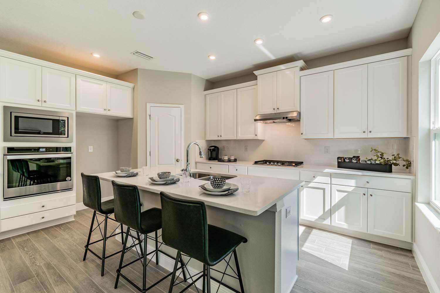 New Tampa Single Family Home Quick Possession Newhaven in Sandhill Ridge, located at 11506 Tanner Ridge Place, Riverview, FL (LOT 11) Built By Cardel Homes Tampa