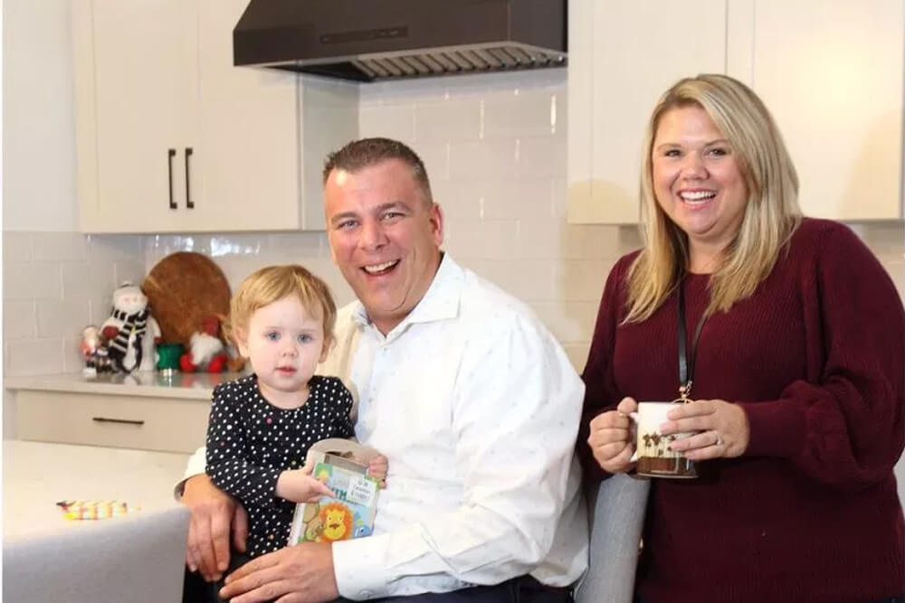 Happy family in a new Shawnee Park home by Cardel Homes