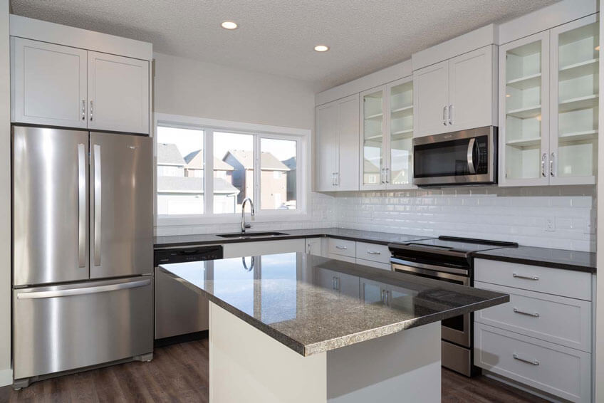 New Calgary Paired Home Quick Possession Indigo 1 in Savanna, located at 9032 52 Street NE Built By Cardel Homes