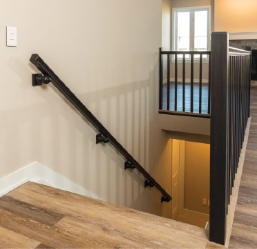 Wider stairs with relocated handrail provides extra maneuverability space