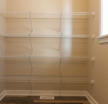 Linen closet located in the laundry room provides convenient, same-room access