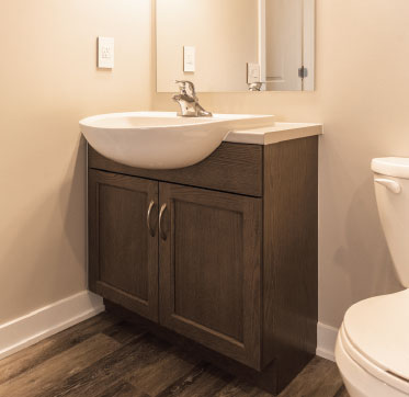 Semi-countertop sinks in the bathrooms allow for a larger sink area that takes up less space