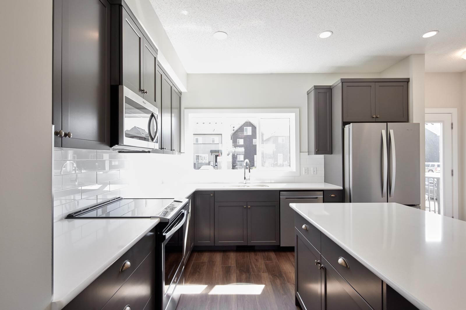 New Calgary Single Family Home Quick Possession Indigo 1 in Savanna, located at 9084 52 Street NE Built By Cardel Homes
