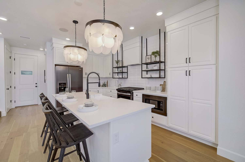 New Denver  Model Home Raine in SaBell, located at 5706 Van Gordon Street Built By Cardel Homes Denver